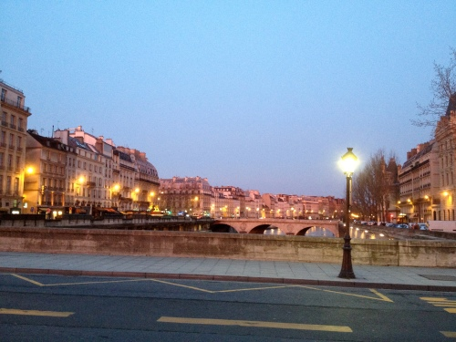 A rosy hue on the buildings facing the other direction