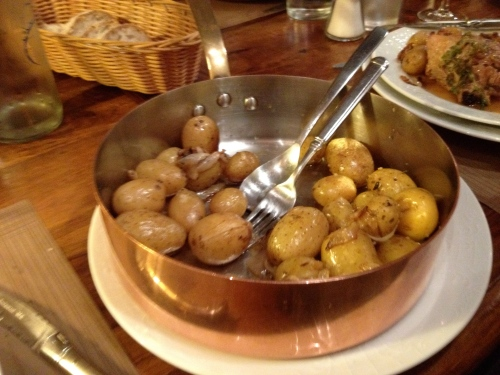 potatoes ini a gorgeous copper skillet accompanied our entrees