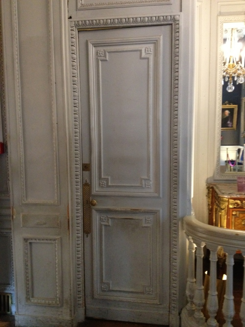 This pretty door was in her first bedroom, before she changed rooms to be closer to her husband's room.