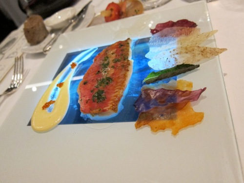 red mullet served on a iPad-like device with a rushing river on the screen