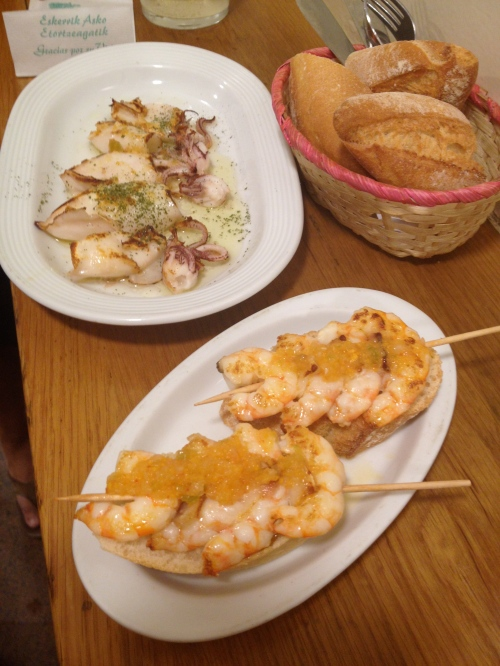 delicious garlic shrimp skewers and grilled octupus