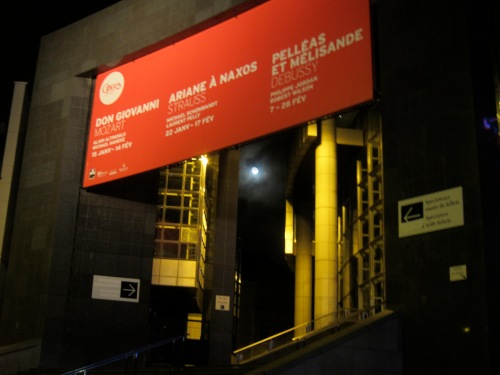 The moon shown down on us through the Bastille Opera.