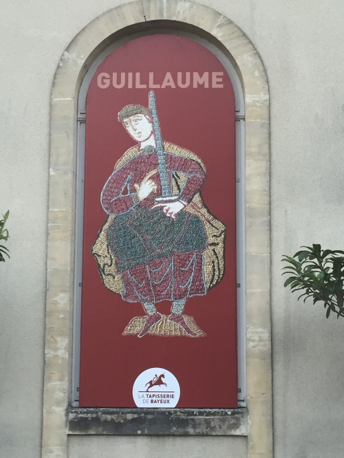 This sign in Bayeux provides an example of the tapestry images.